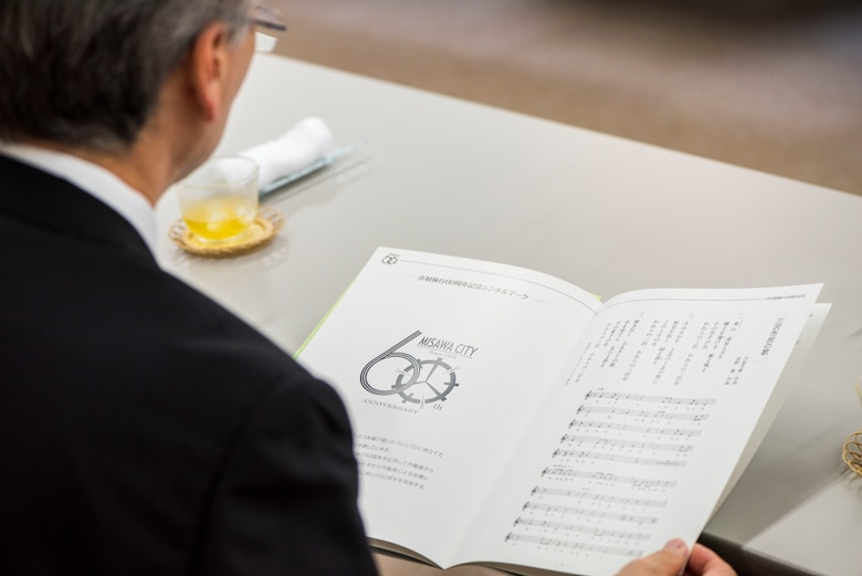 A Misawa City resident reads a brochure during a meeting at the Misawa City 60th anniversary celebration ceremony held at the Misawa International Center in Misawa City, Japan, Sept. 1, 2018. Misawa evolved from a village to a town throughout the years and is now recognized as a city. The city is home to an array of U.S. service members, Japan Air Self-Defense Force members and Japanese citizens. (U.S. Air Force photo by Airman 1st Class Collette Brooks)