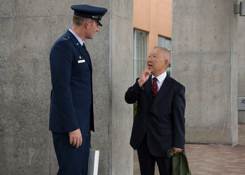 U.S. Air Force Col. Kristopher W. Struve, left, the 35th Fighter Wing commander, speaks with Tetsuro Asano, right, a Misawa City resident, after the Misawa City 60th anniversary celebration ceremony held at the Misawa International Center in Misawa City, Japan, Sept. 1, 2018. Misawa Air Base commanders received recognition during the ceremony for representing a vital part of the region's ongoing progress.  (U.S. Air Force photo by Airman 1st Class Collette Brooks)
