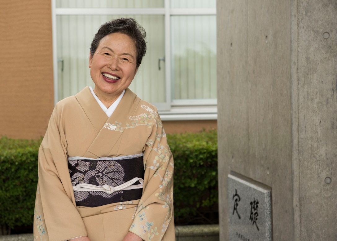 A Misawa City resident poses for a photo at the Misawa City 60th anniversary celebration ceremony held at the Misawa International Center in Misawa City, Japan, Sept. 1, 2018. Kazumasa Taneichi, the Misawa City mayor, noted he is impressed with Misawa City residents' resiliency when faced with challenges such as natural disasters. (U.S. Air Force photo by Airman 1st Class Collette Brooks)