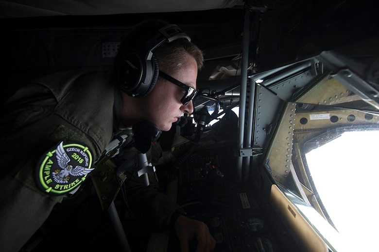 Staff Sgt. Matthew Parker, in-flight refueling specialist, 155th Air Refueling Wing, Nebraska Air National Guard, prepares a KC-135 Stratotanker refueling aircraft to top off an F-16 Fighting Falcon aircraft  assigned to the 162nd Wing, Arizona Air National Guard, over Pardubice Air Base, Czech Republic, during Exercise Ample Strike 2018. Ample Strike is a Czech Republic-led exercise with aircraft and participants conducting day and night operations out of the Czech Republic to improve NATO allies and partner nation interoperability.  Our presence in Europe and the relationships built among our NATO allies and European partners provide the United States the strategic access critical to meet our commitment to respond to threats against them. (U.S. Air National Guard Photo by Tech. Sgt. Rana Franklin)