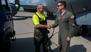 Staff Sgt. Matthew Parker, in-flight refueling specialist, 155th Air Refueling Wing, Nebraska Air National Guard thanks a ground service technician assigned to Pardubice Air Base, Czech Republic, after completing a refueling flight during Exercise Ample Strike 2018 at Pardubice Air Base.  Ample Strike is a Czech Republic-led exercise with aircraft and participants conducting day and night operations out of the Czech Republic to improve NATO allies and partner nation interoperability.  The 155 ARW's presence in Europe and the relationship built between Nebraska and the Czech Republic through the State Partnership Program provides the United States the strategic access critical to meet our commitment to respond to threats against them. (U.S. Air National Guard Photo by Tech. Sgt. Rana Franklin)
