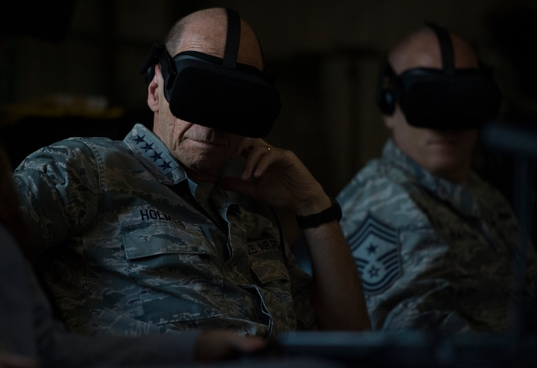 U.S. Air Force Gen. Mike Holmes, commander of Air Combat Command, and Chief Master Sgt. Frank Batten, command chief of Air Combat Command, use virtual reality technology during a visit to the 363rd Intelligence Surveillance Reconnaissance Wing at Joint Base Langley-Eustis, Virginia, Sept. 5, 2018. Through innovation, the 363rd ISRW uses its analytical capabilities and targeting expertise, to pull meaningful patterns from collected intelligence data to produce made-to-order targeting products for operational and tactical-level warfighters. (U.S. Air Force photo by Staff Sgt. Areca T. Bell)