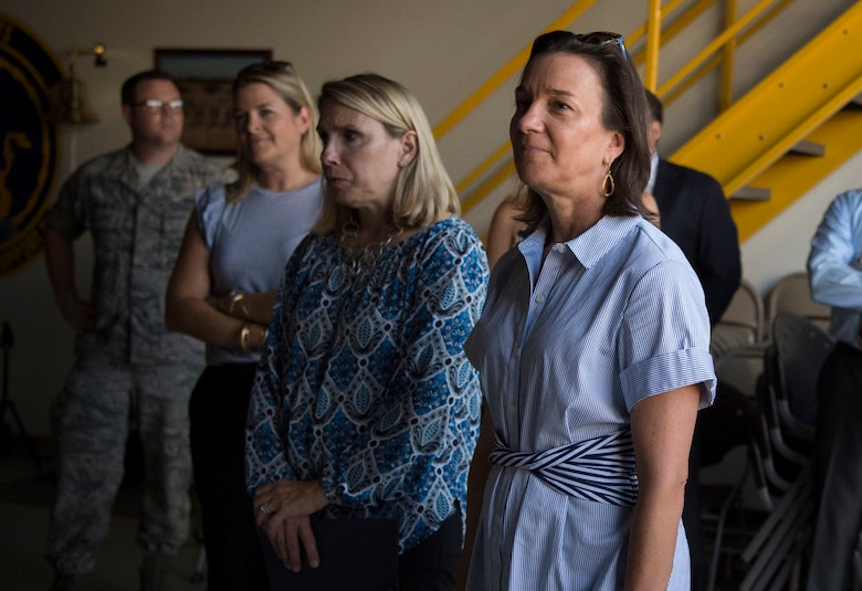 Right, Sara Holmes, wife of U.S. Air Force Gen. Mike Holmes, commander of Air Combat Command, attends a mission brief during a visit to the 363rd Intelligence Surveillance Reconnaissance Wing at Joint Base Langley-Eustis, Virginia, Sept. 5, 2018. Holmes visited various units within the 363rd ISRW to learn about its mission and Airmen. (U.S. Air Force photo by Staff Sgt. Areca T. Bell)
