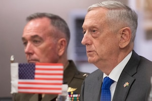 Defense Secretary James N. Mattis and Marine Corps Gen. Joe Dunford, chairman of the Joint Chiefs of Staff,attend a meeting.