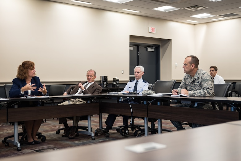Brig. Gen. Edward L. Vaughan (far right), the Air Force Unexplained Physiological Events Integration Team lead, listens to Jennie Farrell, chief engineer for the Human Systems Division of the Agile Combat Support Directorate of Air Force Life Cycle Management Systems. Also pictured are Patrick Bolibrzuch, deputy program manager for the Training Aircraft Division of AFLCMC; and Col. William Nelson, chief of Integrated and International Operational Medicine in the 711th Human Performance Wing. (U.S. Air Force photo by Richard Eldridge)