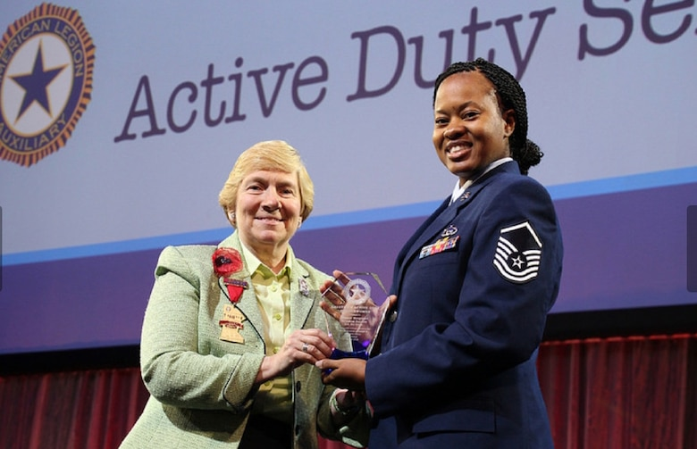 Master Sgt. Kendra Sorice, 70th ISRW Inspector General Complaints and Resolutions superintendent, receives the 2017-2018 Servicewomen of the Year for the U.S. Air Force from Diane Duscheck, American Legion Auxiliary National President, during the 98th Annual National Convention, August 27, 2018 in Minneapolis, Minnesota. Established in 2003, the Salute to Servicewomen Award has evolved from honoring women veterans to honoring women who are currently serving in the U.S. Army, Navy, Marine Corps, Air force and Coast Guard, including the National Guard and Reserve components of each branch.  (Courtesy photo)