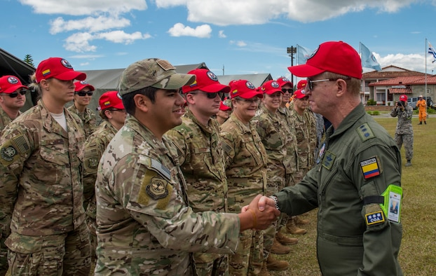 U.S. Air Force Staff Sgt. Joseph Eli Elizondo, 571st Mobility Support Advisory Squadron force protection team sergeant, greets Colombian Air Force Chief of Staff Gen. Carlos Eduardo Bueno Vargas, during the opening ceremony of exercise Angel de los Andes, Sept. 3, 2018, at Air Combat Command-5, Rionegro, Colombia.  Angel de los Andes is a search and rescue exercise hosted by Colombia involving 12 partner nations that will work together in a joint environment and focus on exercising search and rescue, aeromedical evacuation and casualty evacuation operations. (U.S. Air Force Photo by Staff Sgt. Robert Hicks)