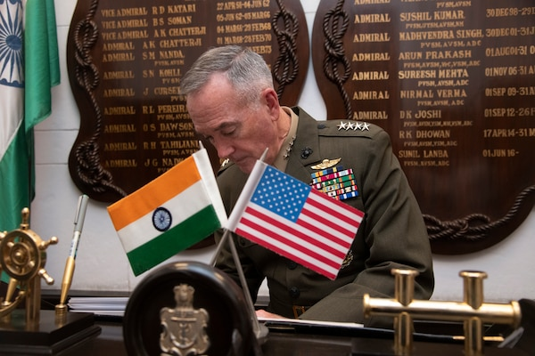 Marine Corps Gen. Joe Dunford, chairman of the Joint Chiefs of Staff, signs the guestbook of Indian Adm. Sunil Lanba, PVSM, AVSM, ADC, Indian Chief of the Naval Staff and Chairman of the chiefs of staff committee at the Ministry of Defence in New Delhi, India Sept. 6, 2018.
