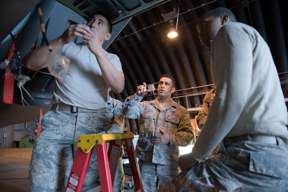 A 372nd Training Squadron, Field Training Detachment 16 instructor explains maintenance procedures during the F-15 Eagle hydraulics class at Royal Air Force Lakenheath, England, Aug. 23, 2018. The 372nd 372nd TRS DET 16 provides students with an aircraft specifically used for training purposes, so that active aircraft are not pulled from mission essential priorities. (U.S. Air Force photo/Airman 1st Class Christopher S. Sparks)
