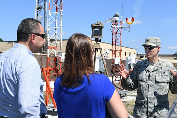 Maj. Andrew Travis, right, Battle Management directorate weather division staff meteorologist speaks with Ted Papadopoulos, a foreign military sales chief engineer and Janna Miller, an FMS lead engineer at the Weather Engineering Facility ribbon cutting ceremony, Hanscom Air Force Base, Mass., Sept 5.