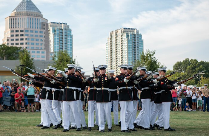 The Silent Drill platoon performs at Marine Week Charlotte in downtown Charlotte, N.C., Sept. 5, 2018. Marine Week is an annual event that allows members of the Marine Corps to demonstrate their capabilities and allows the public to interact with service members. Marine Week Charlotte is an opportunity for Marines to reconnect with our Marines, sailors, veterans, and their families from different generations.