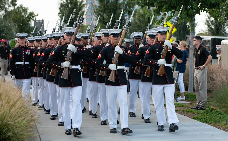The Silent Drill Platoon exits Marine Week Charlotte's opening ceremony in downtown Charlotte, N.C., Sept. 5, 2018. Marine Week is an annual event that allows members of the Marine Corps to demonstrate their capabilities and allows the public to interact with service members. Marine Week Charlotte is an opportunity for Marines to reconnect with our Marines, sailors, veterans, and their families from different generations.