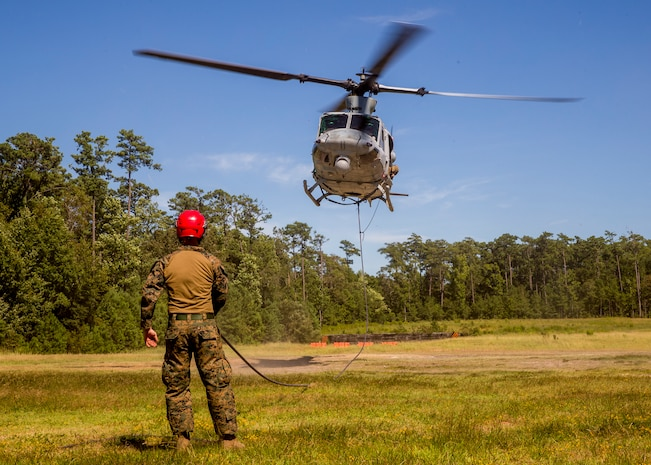 U.S. Marines conduct a special patrol insertion and extraction rigging exercise on Stone Bay, N.C., Aug. 29, 2018. Marine Light Attack Helicopter Squadron 167 supported the helicopter rope suspension technic masters course which certifies Marines in the ability to land and take off quickly in situations where the aircraft may have difficulty landing. HMLA-167 is a part of Marine Aircraft Group 29, 2nd Marine Aircraft Wing.