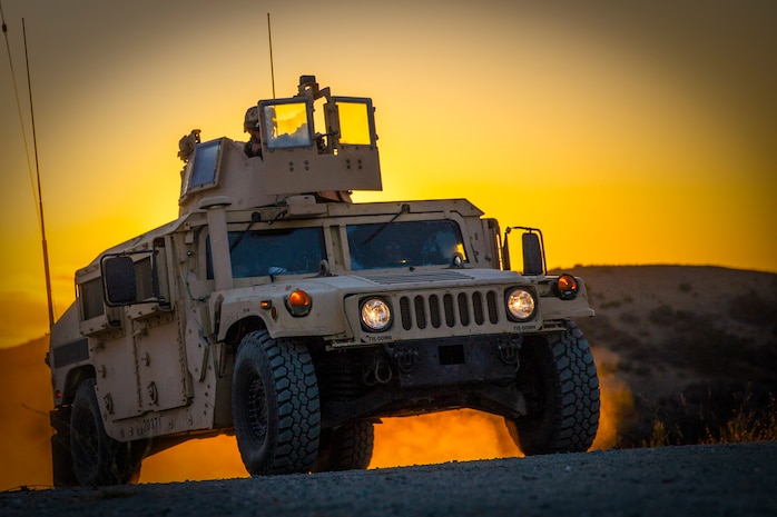 U.S. Marines with Combat Service Support Company, I Marine Expeditionary Force Support Battalion, I Marine Expeditionary Force, patrol in a humvee during a field exercise at Marine Corps Base Camp Pendleton, Calif., Aug. 14, 2018. The FEX exposed battalion Marines to field conditions, and will prepare them to meet operational and training objectives in the upcoming year.