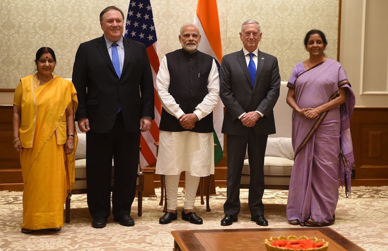 U.S. and Indian leaders pose for a photo.