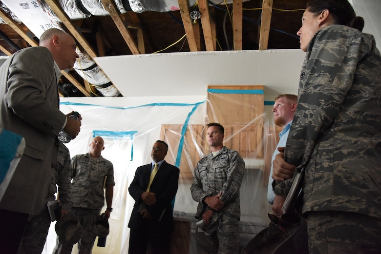 John Hoyt, Hunt military communities vice president, explains the remediation work being accomplished by Hunt inside base housing to Keesler leadership at Bay Ridge Housing on Keesler Air Force Base, Mississippi, Aug. 28, 2018. Base leadership took time to better understand the process of mold remediation in base housing in order to better serve the Airmen who live there. (U.S. Air Force photo by Kemberly Groue)