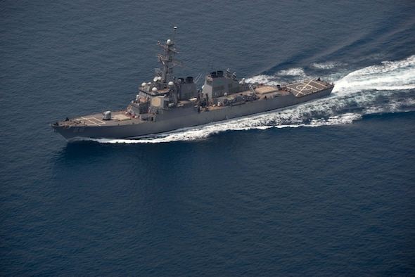 The guided missile destroyer USS The Sullivans conducts a routine transit through the Strait of Hormuz.