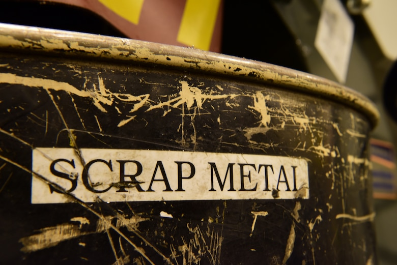 One of the many scrap metal bins spread throughout the 28th Maintenance Squadron metals technology shop lays open for unserviceable metal pieces. The metals technology shop runs 24-hour operations to provide different metals technologies for all squadrons on base. (U.S. Air Force photo by Airman John Ennis)