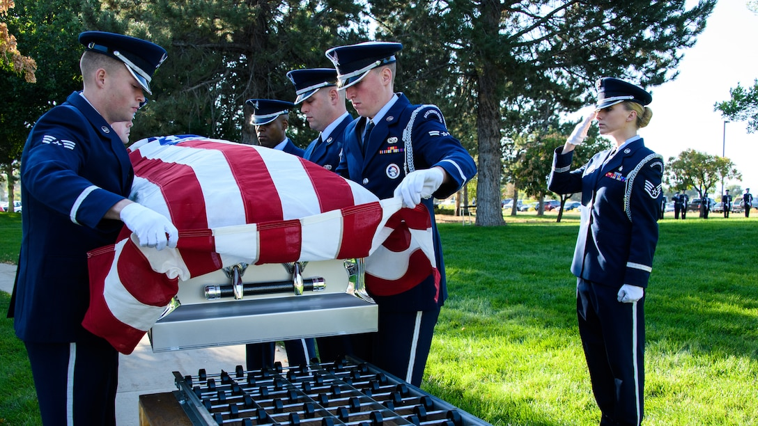 Honor guard members perform a full-honors funeral during their graduation ceremony at Hill Air Force Base, Utah, on Aug. 29, 2018. The active-duty funeral service requires a minimum 20-member team and encompasses all honor guard funeral service duties. (U.S. Air Force photo by R. Nial Bradshaw)