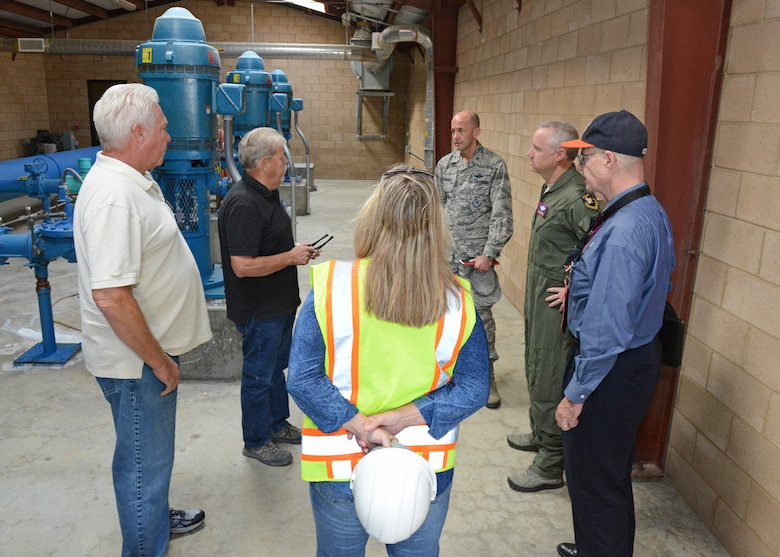 Thomas Allen, 412th Civil Engineer Squadron, shows how the Edwards Wastewater Treatment Plant is laid out to a tour group Sept. 4. The treatment plant was built in 1996. (U.S. Air Force photo by Kenji Thuloweit)