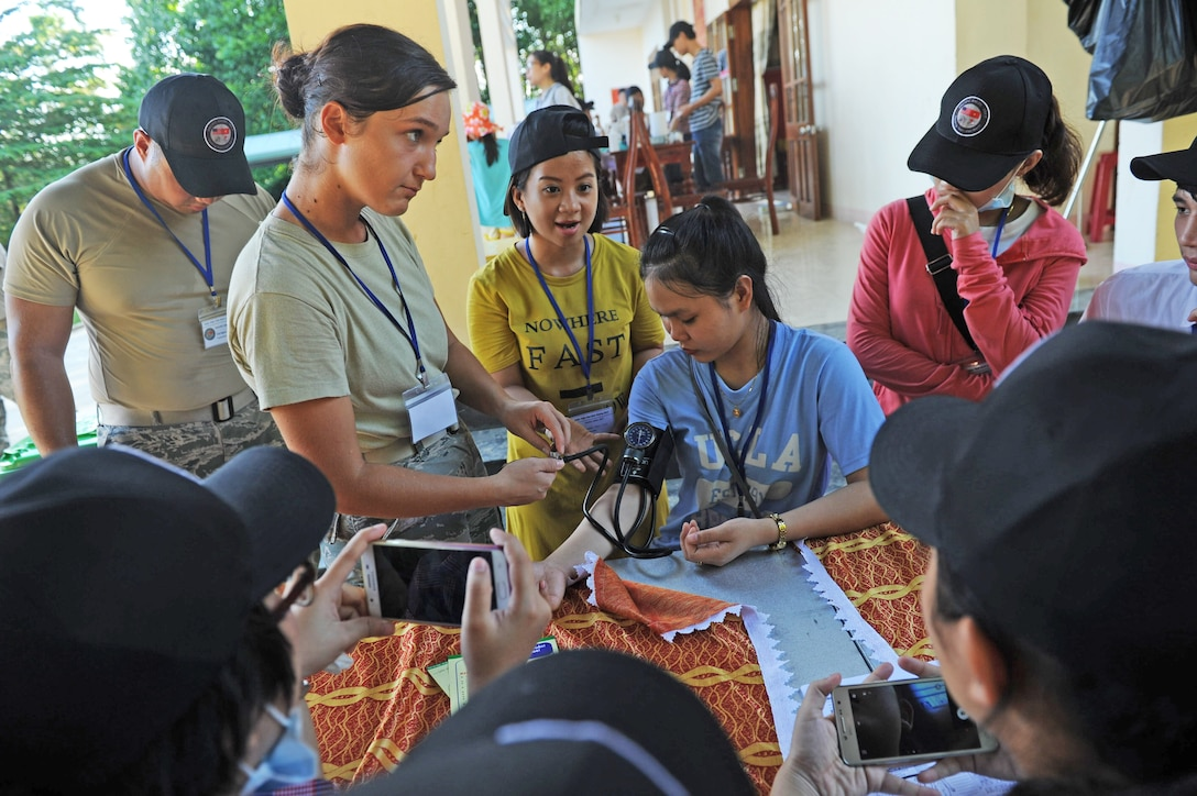 U.S. Air Force Senior Airman Arlinda Haliti, a medical technician, assigned to the 15th Medical Operations Squadron, Hickam Air Force Base, Hawaii, briefs Vietnamese nursing student volunteers on the proper procedures for taking blood pressure readings at a health services outreach site during Pacific Angel (PACANGEL) 17-2 in Tam Ky, Vietnam, Sept. 11, 2017