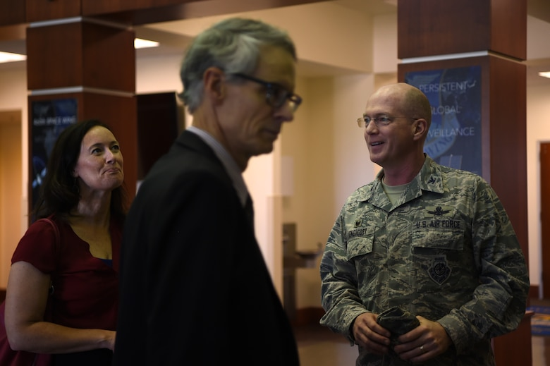 Col. Troy Endicott, 460th Space Wing commander, gives a brief history of the 460th headquarters building to Aurora city officials, Sept. 5, 2018, on Buckley Air Force Base, Colorado. The mission of the 460th SW is to deliver global infrared surveillance, tracking and missile warning for theater and homeland defense and provide combatant commanders with expeditionary warrior Airmen. (U.S. Air Force photo by Airman 1st Class Codie Collins)