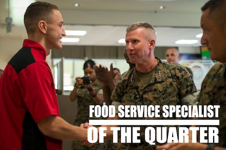 Lt. Gen. Eric Smith congratulates Pfc. Dominic Marimonti, for winning first place in the Food Specialist of the Quarter competition at Camp Kinser, Okinawa, Japan, Aug. 30, 2018. Smith is the commanding general of III Marine Expeditionary Force. Marimonti is a food service specialist with 3rd Marine Logistic Group Headquarters Regiment and is a native of St. Louis, Missouri. He competed in the competition to expand his culinary knowledge and test his abilities. (U.S. Marine Corps photo by Pfc. Kindo Go)