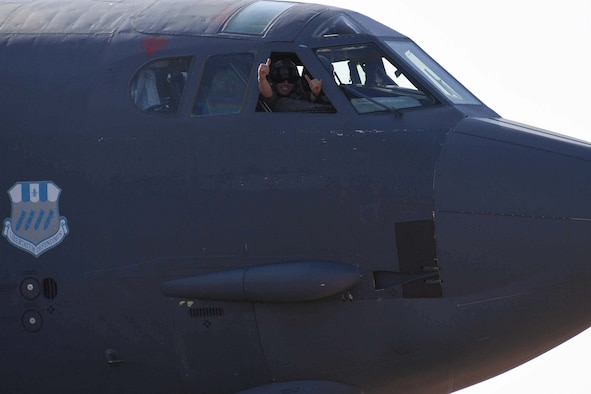 A B-52 Stratfortress pilot gives the thumbs up sign after arriving at RAF Fairford, United Kingdom, Sept. 5, 2018.   The jet arrived from Barksdale Air Force Base, Louisiana and is in the U.K. as part of the Air Force's bomber task force operations.  Such operations are routinely conducted to demonstrate the United States' commitment to allies and partners in the region and enhance readiness to respond to any contingencies around the globe.  They also provide opportunities to work with allies and partners in the region. (U.S. Air Force photo by Master Sgt. Ted Daigle/not released)