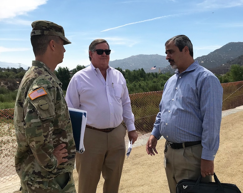From left to right, Col. Aaron Barta, U.S. Army Corps of Engineers Los Angeles District commander; Rep. Ken Calvert, 42nd Congressional District, California; and Jason Uhley, general manager of the Riverside County Flood Control District, discuss the Murrieta Creek Flood Protection and Environmental Restoration project during an Aug. 28 site visit in Temecula, California.
