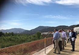 Representatives with the U.S. Army Corps of Engineers Los Angeles District, the City of Temecula, Riverside County Flood Control District and Rep. Ken Calvert, 42nd Congressional District, look at Phase 1 of the Murrieta Creek Flood Protection and Environmental Restoration project during an Aug. 28 site visit in Temecula, California.