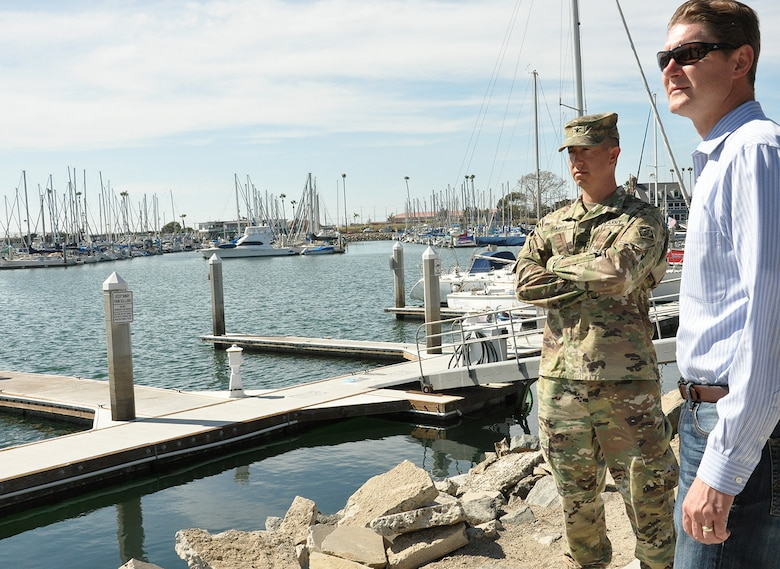 Col. Aaron Barta, U.S. Army Corps of Engineers Los Angeles District commander, left, and David Van Dorpe, deputy District engineer, LA District, right, look out over Oceanside Harbor following an Aug. 28 meeting with Oceanside city and harbor officials about the upcoming maintenance dredging of the entrance channel to the harbor, which is scheduled for October.