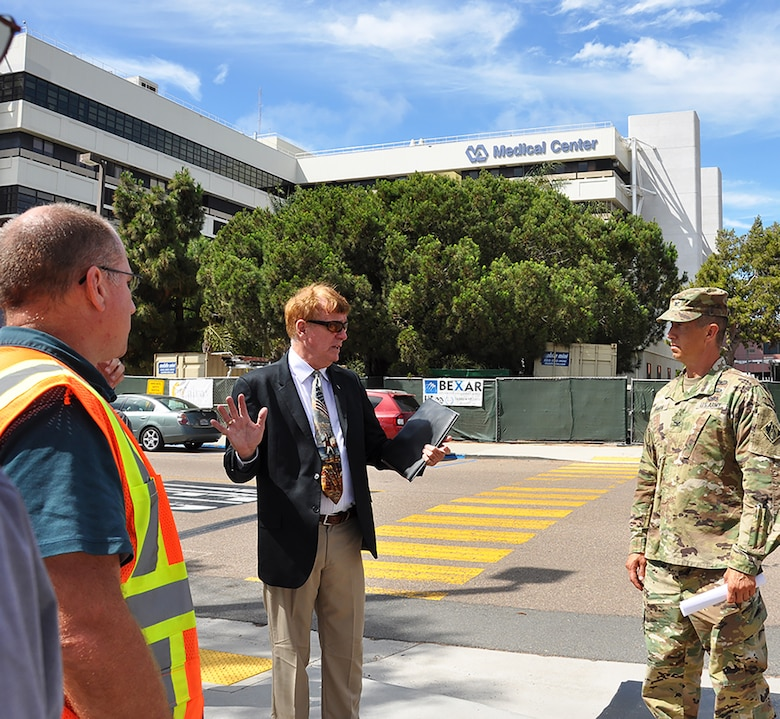 Robert Klein, project manager with the U.S. Army Corps of Engineers Los Angeles District, center, discusses the Corps' San Diego Veterans Affairs project with Col. Aaron Barta, LA District commander, right, while Shaun Frost, area engineer with the Construction Division, Southern California Area Office, LA District, left, looks on during an Aug. 29 site visit to the hospital in San Diego, California.