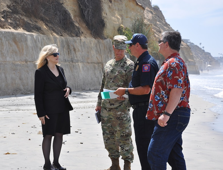 Col. Aaron Barta, U.S. Army Corps of Engineers Los Angeles District commander, second from left, meets with representatives from the City of Encinitas to discuss the Corps' Encinitas and Solana Beach Coastal Storm Damage Reduction project during an Aug. 29 site visit at Moonlight Beach in Encinitas, California.