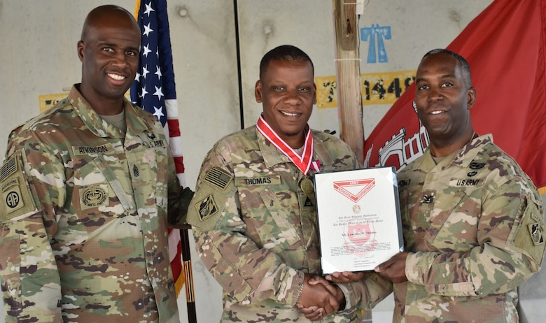 Afghanistan District Command Sergeant Major Nathaniel Atkinson and District Commander Jason Kelly present Lawrence Thomas with the DeFleury Award Certificate at Bagram Airfield. There are four levels of the de Fleury Medal: steel, bronze, silver and gold. Only one gold medal is awarded each year by the U. S. Army Chief of Engineers.