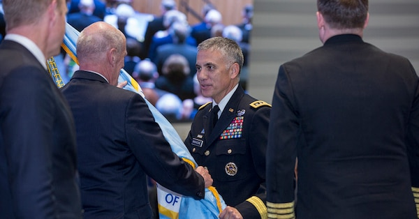 General Nakasone accepts the NSA/CSS flag at his swearing in ceremony.