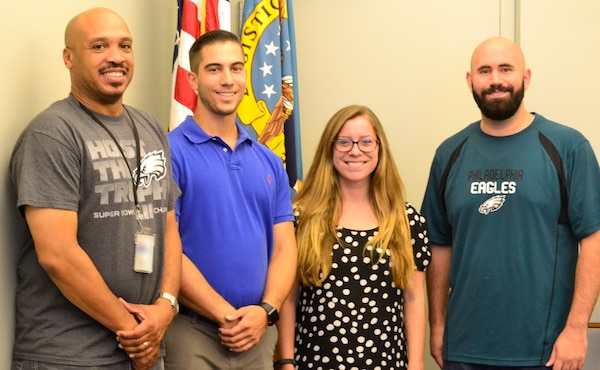 """From left to right, acquisition professionals Craig Singleton, Ryan Cunningham, Rebecca Gormley and Nicholas Rossi, from DLA Troop Support's Industrial Hardware supply chain, pose after conducting a """"CON 090 Boot Camp"""" training session Sept. 6 in Philadelphia."""