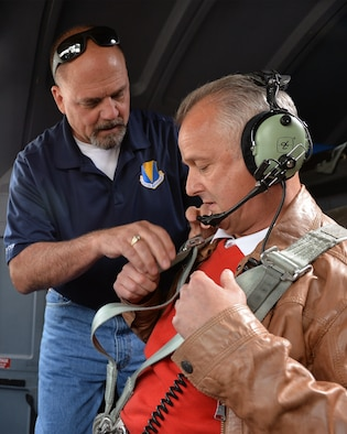Scott C. Lockard, 86th Airlift Wing vice director, assists Markus Vollmer, a local civic leader, with a C-130J Super Hercules seatbelt on Ramstein Air Base, Germany, Aug. 31, 2018. Host nation civic leaders and their spouses were invited to tour the base and learn about Ramstein's missions.