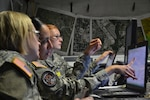 Capt. Jennifer Staton, a space operations officer, Sgt. Cassandra Quinones and Pfc. Miranda Yost, geospatial engineers, use mapping software during the multi-state large-scale, natural disaster emergency response exercise Vigilant Guard 2014, hosted by the Kansas National Guard in Salina, Kan., Aug. 4-7. The Soldiers are a part of Army Space Support Team 30, 117th Space Support Battalion with the Colorado National Guard. (Photo by Capt. Benjamin Gruver, 105th Mobile Public Affairs Detachment)