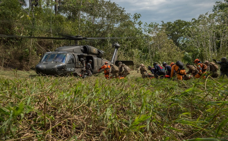 The Colombian civil defense team, firefighters and Peruvian Airmen load triage patients onto a Colombian UH-60 Blackhawk during exercise Angel de los Andes Sept. 5, 2018 at German Olano Air Base, Colombia. Angel de los Andes is a search and rescue exercise hosted by Colombia involving 12 partner nations that will work together in a joint environment and focus on exercising search and rescue, aeromedical evacuation and casualty evacuation operations. (U.S. Air Force photo by Staff Sgt. Robert Hicks)