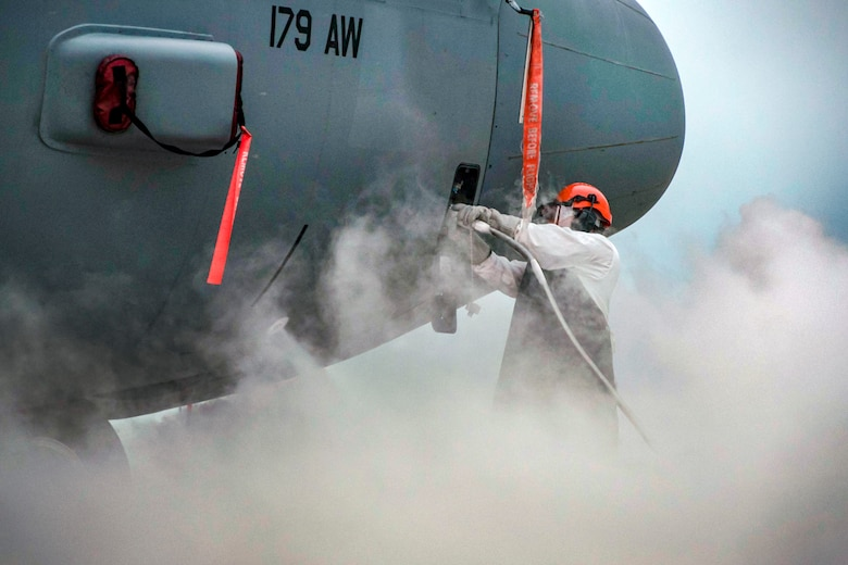 Senior Airman Brandon M. Acks, 179th Airlift Wing Maintenance Group crew chief, refills a C-130H Hercules with liquid oxygen August 30, 2018, at Mansfield, Ohio. (U.S. Air National Guard photo by Airman Alexis Wade)