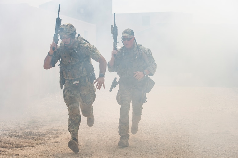 Students run for cover during a full spectrum operator course, Aug. 30, 2018, at Smoky Hill Air National Guard Range, Kan. The course was held Aug. 26-31, and incorporated specific duties performed by tactical air control party members and security forces personnel to build on their gunfighting skills. (U.S. Air Force photo by Senior Airman Janiqua P. Robinson)