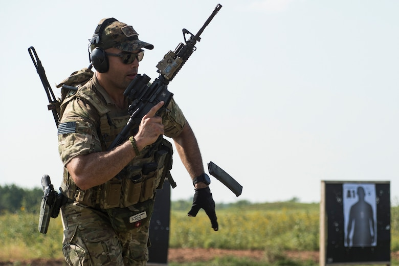 A student reloads an M4 carbine during a full spectrum operator course, Aug. 28, 2018, at Smoky Hill Air National Guard Range, Kan. The course was held Aug. 26-31, and incorporated specific duties performed by tactical air control party members and security forces personnel to build on their gunfighting skills. (U.S. Air Force photo by Senior Airman Janiqua P. Robinson)