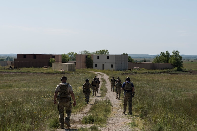 Students trek into a simulated village during a full spectrum operator course, Aug. 29, 2018, at Smoky Hill Air National Guard Range, Kan. The course was held Aug. 26-31, and incorporated specific duties performed by tactical air control party members and security forces personnel to build on their gunfighting skills. (U.S. Air Force photo by Senior Airman Janiqua P. Robinson)