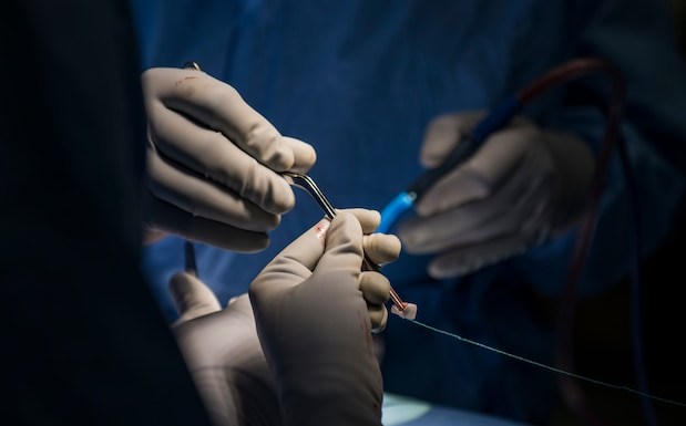 Airmen assigned to the 99th Medical Group perform in an orthopedic spine surgery at Nellis Air Force Base, Nevada, Aug. 27, 2018. Having in-house surgeons allows patients to bypass referrals downtown. (U.S. Air Force photo by Airman 1st Class Andrew D. Sarver)