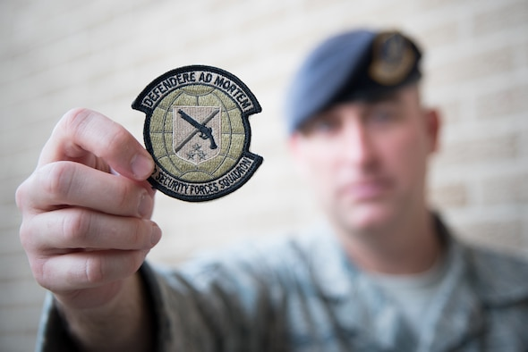 Master Sgt. Lucas Applewhite, 403rd Security Forces Squadron action officer, displays the new 403rd SFS unit patch Nov. 7, 2017 at Keesler Air Force Base, Mississippi. (U.S. Air Force photo by Staff Sgt. Heather Heiney)