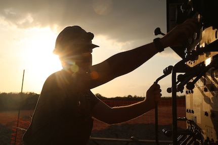 A U.S. Navy Equipment Operator drills during water well drilling exploration operations in Riohacha, Colombia.