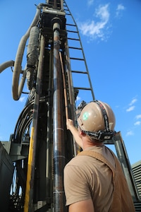 U.S. Navy Sailors drill during water well drilling exploration operations in Riohacha, Colombia.