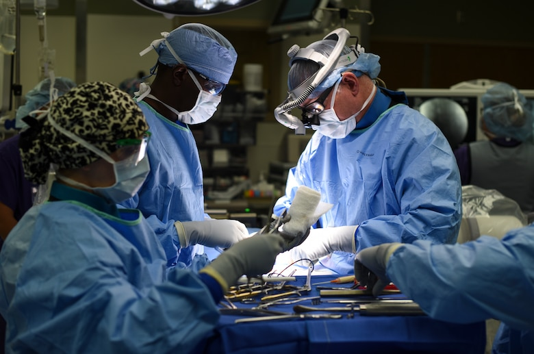 Col. (Dr.) Edward Anderson, 99th Medical Group orthopedic spine surgeon, performs a lumbar microdiscectomy surgery at Nellis Air Force Base, Nevada, Aug. 27, 2018. A lumbar microdiscectomy surgery is performed to remove a portion of a herniated disc in the lower back. (U.S. Air Force photo by Airman 1st Class Andrew D. Sarver)