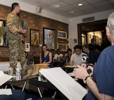U.S Air Force Staff Sgt. Eric Shenton, 87th Security Forces Squadron military working dog handler, pose with his K-9 Kkrusty during a sketch night at the Society of Illustrators Museum in New York, Aug. 30, 2018. Shenton talked about Kkrusty's military service since the last time he posed for sketch night.