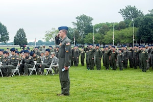 "U.S. Air Force Master Sgt. Ken, 97th Intelligence Squadron superintendent of operations support, stands and salutes along with a formation of 97th IS Airman as ""Taps,"" plays during the 60528 Remembrance Ceremony Aug. 30, 2018, at Offutt Air Force Base, Nebraska. The ceremony was held in remembrance of 17 crewmembers who lost their lives when 60528, a C-130 modified to fly reconnaissance missions, was shot down during the Cold War.  (U.S. Air Force photo by L. Cunningham)"